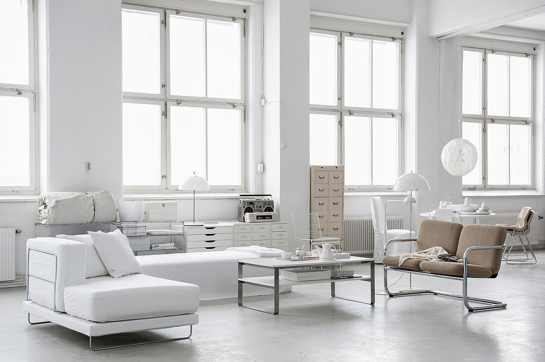 Modern loft-apartment living room decorated entirely in white