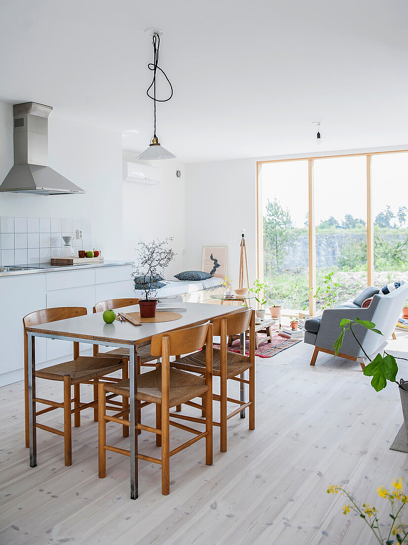Dining area and kitchen counter with lounge area in background