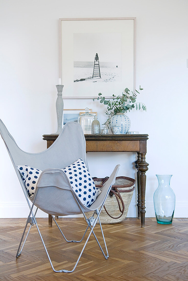 Polka-dot Butterfly Chair in front of old console table