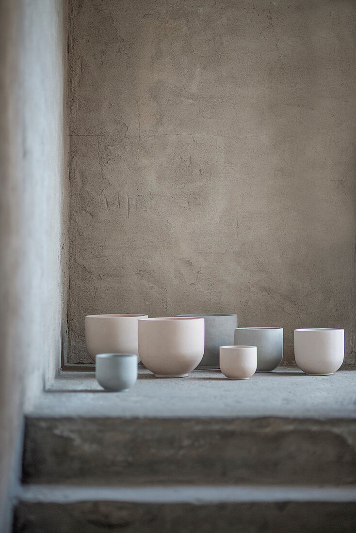 Pastel-coloured beakers of various sizes