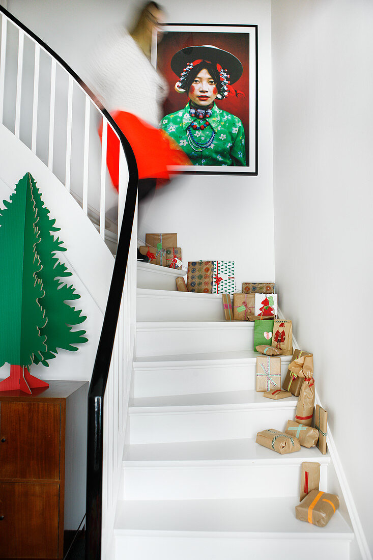 Wrapped gifts and Christmas decorations on white stairs