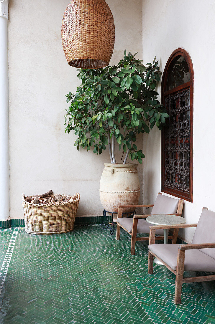 Green herringbone floor tiles on Oriental-style terrace
