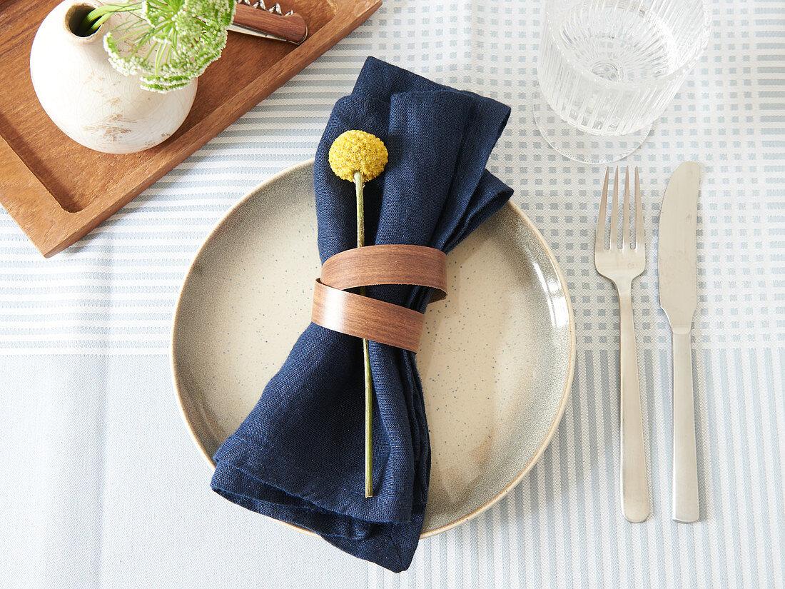 DIY napkin ring made from edging strip