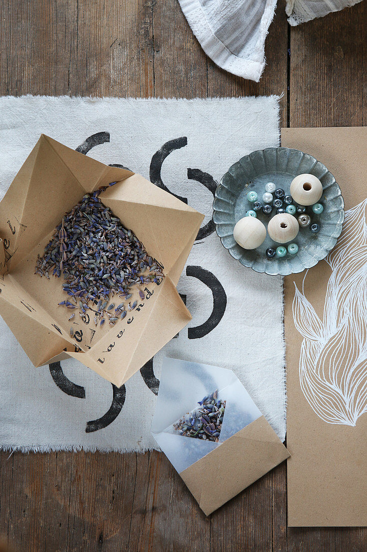 Handcrafted envelope and box filled with lavender flowers