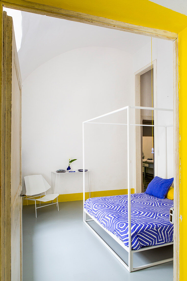 View into bedroom with yellow and blue accents