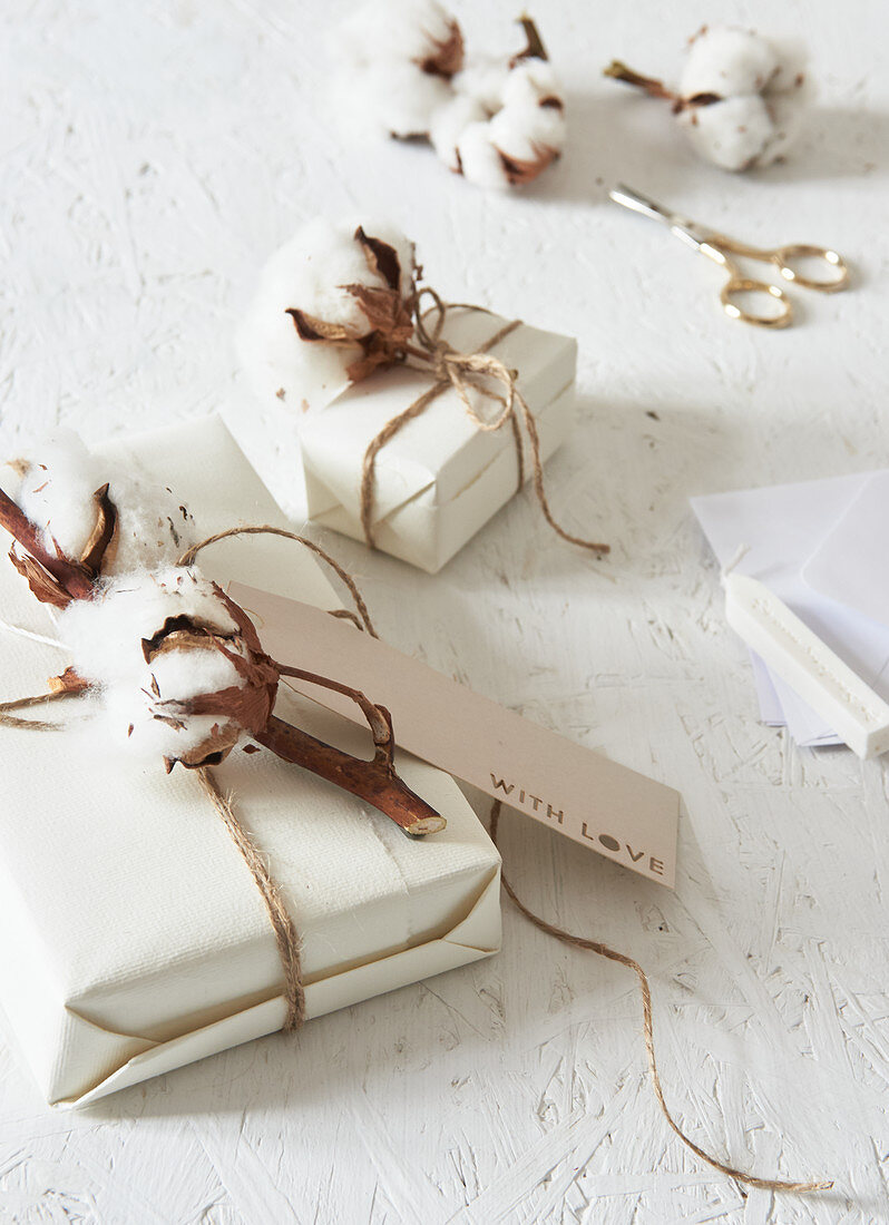 Cotton bolls and tags decorating wrapped gifts