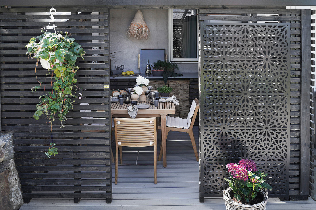 View through Moroccan sliding doors onto terrace