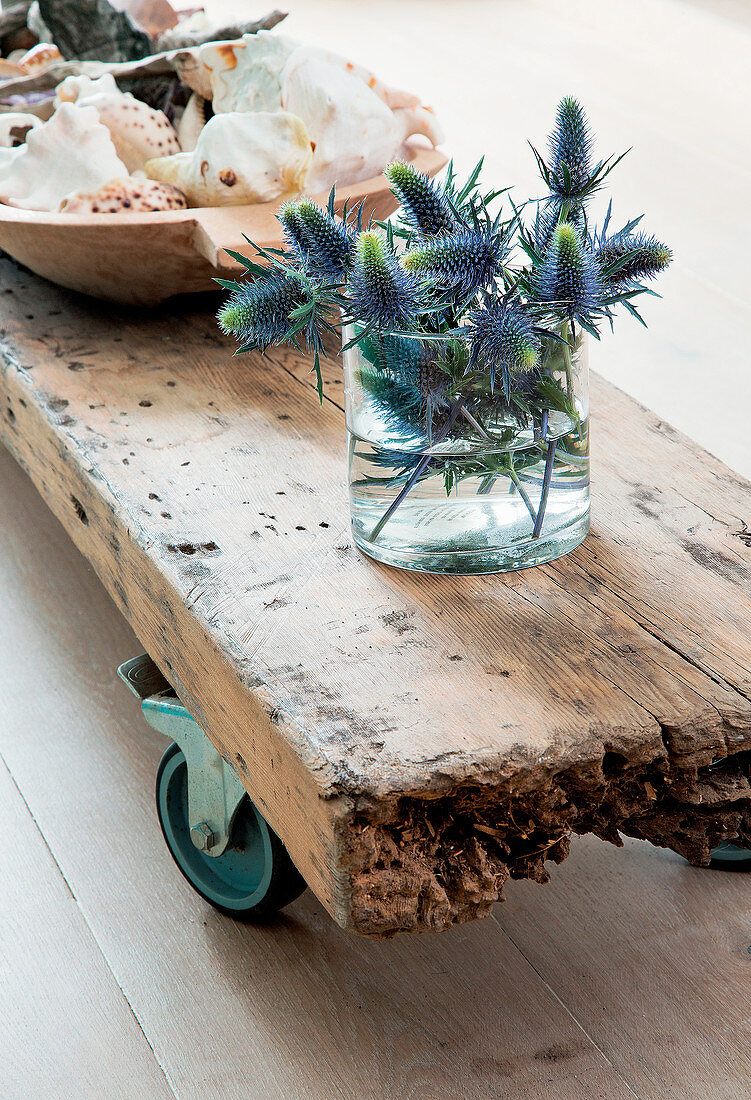 Decorative and functional coffee table made from wooden plank with castors