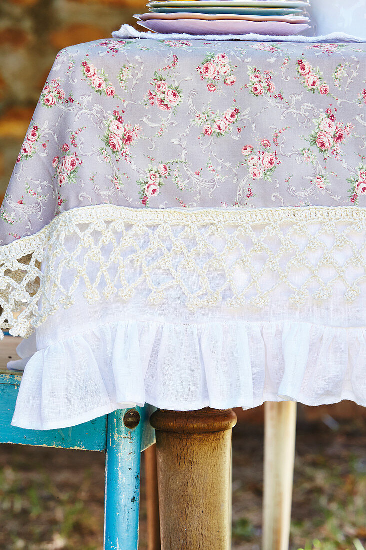 Pretty tablecloth with floral pattern, crocheted border and flounce