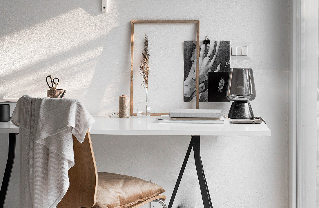 Ornaments on simple desk with white top