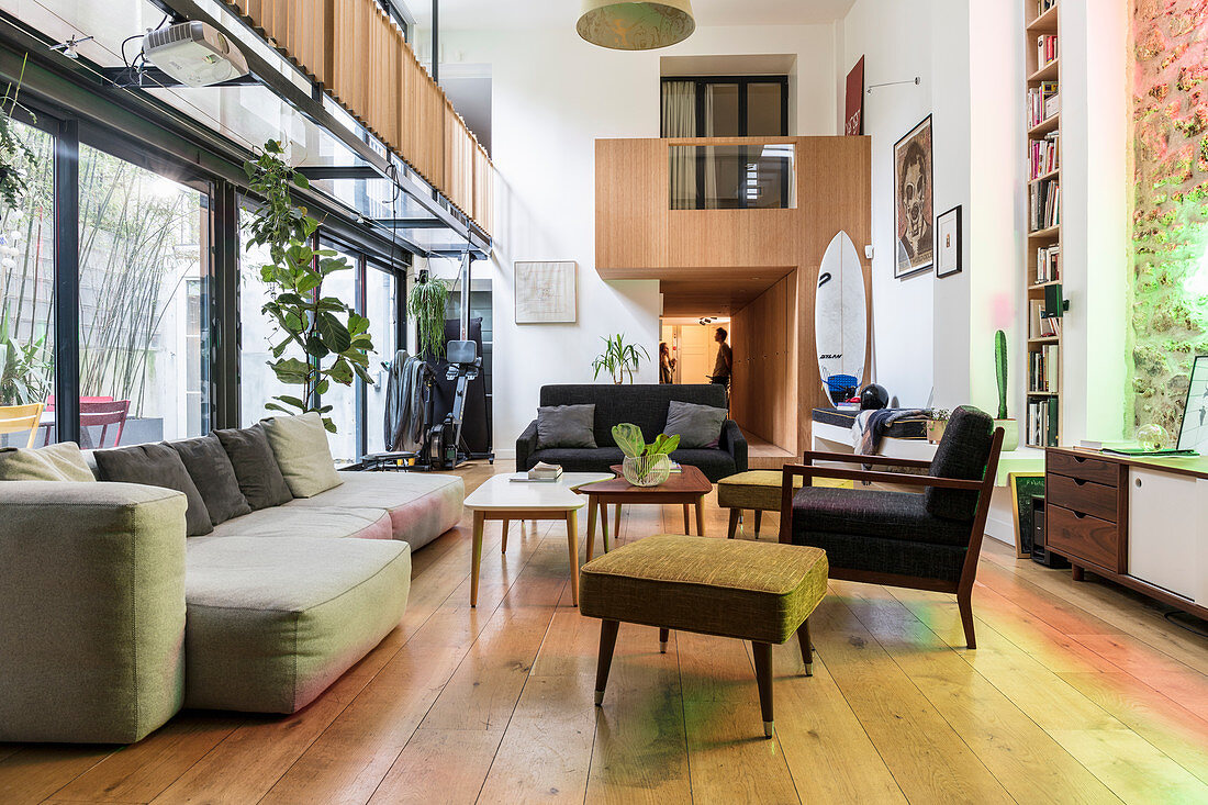 Lounge area in loft apartment with gallery