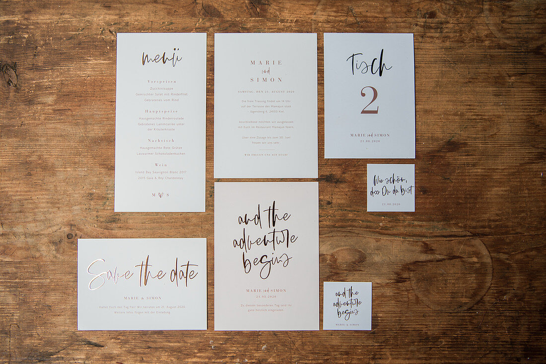 Various wedding cards on wooden surface