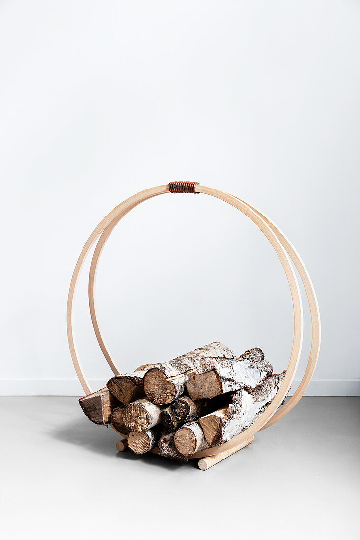 DIY firewood rack made from hulahoops