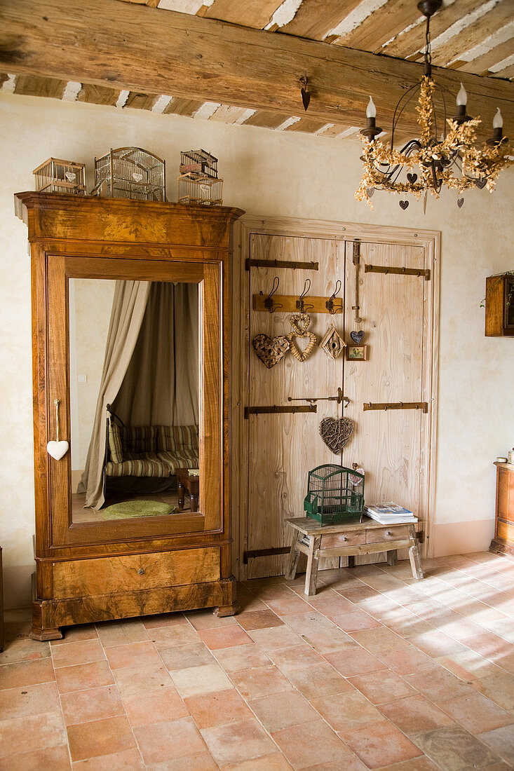 Old cupboard with a mirror door in a rustic country house