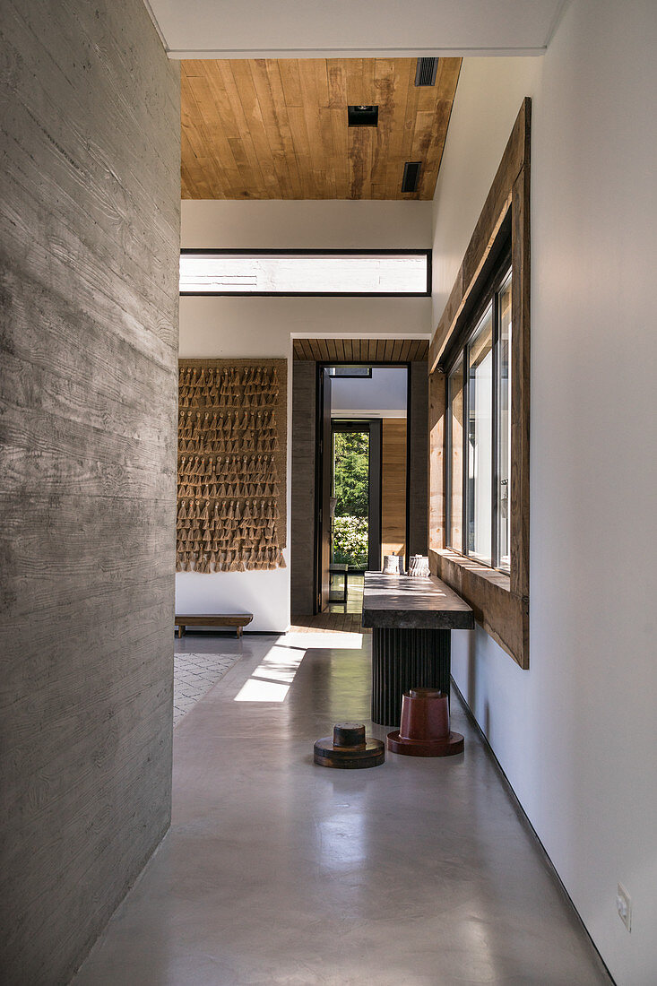 Hallway in modern, architect-designed house with concrete walls and floor
