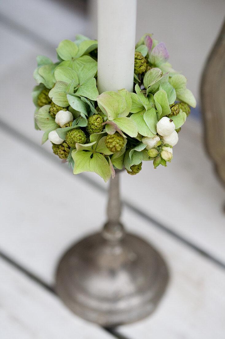 Wreath of green hydrangeas, pinecones, and snowberries