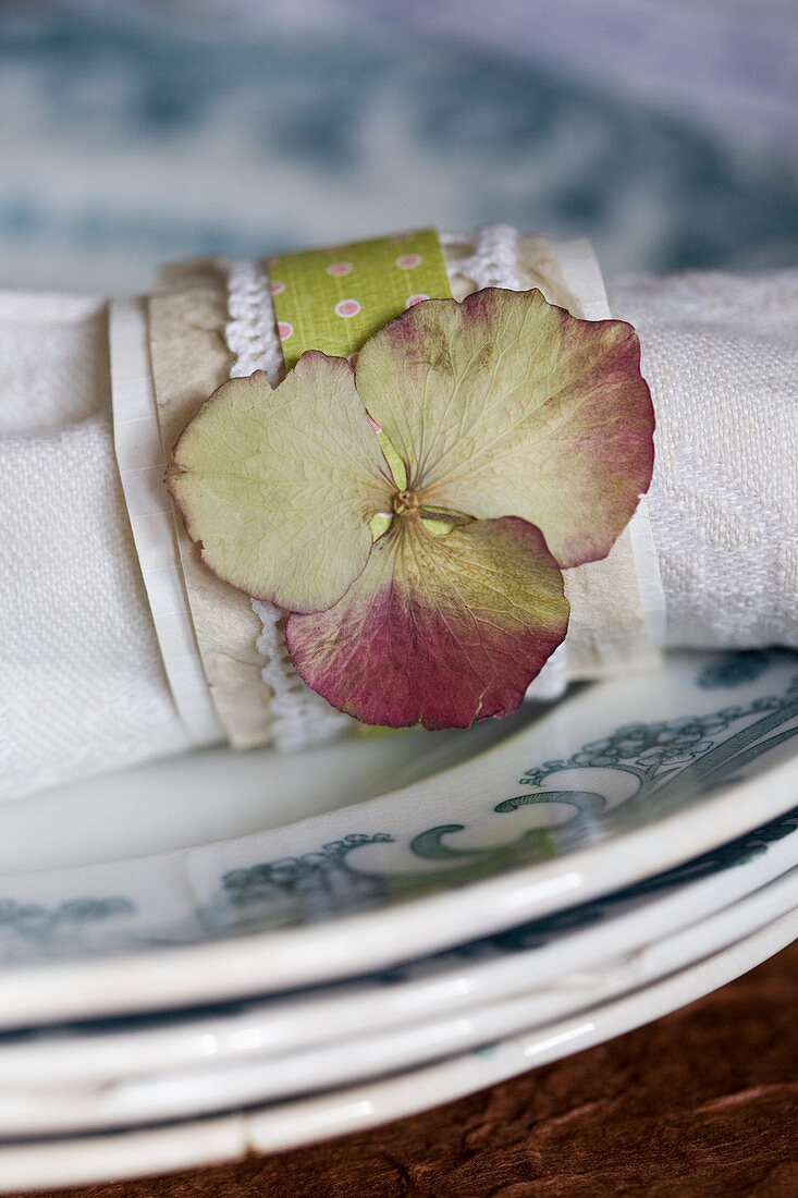 Homemade napkin ring with a dried hydrangea
