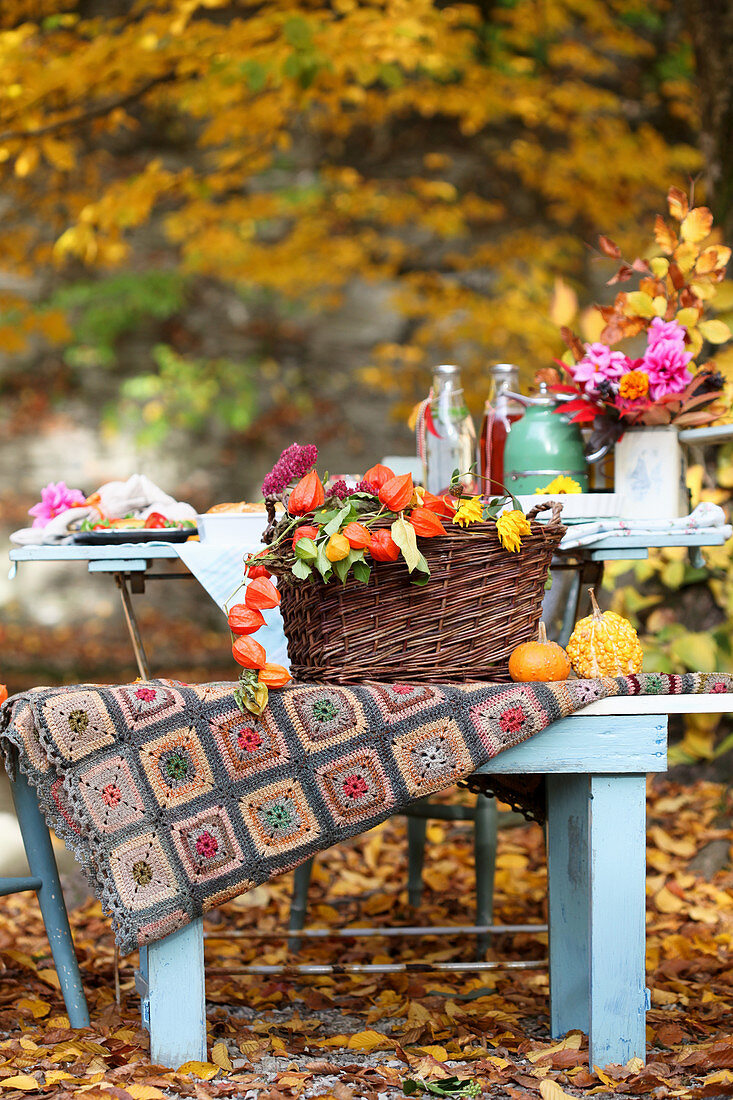 Autumn decoration and table setting in the autumn garden