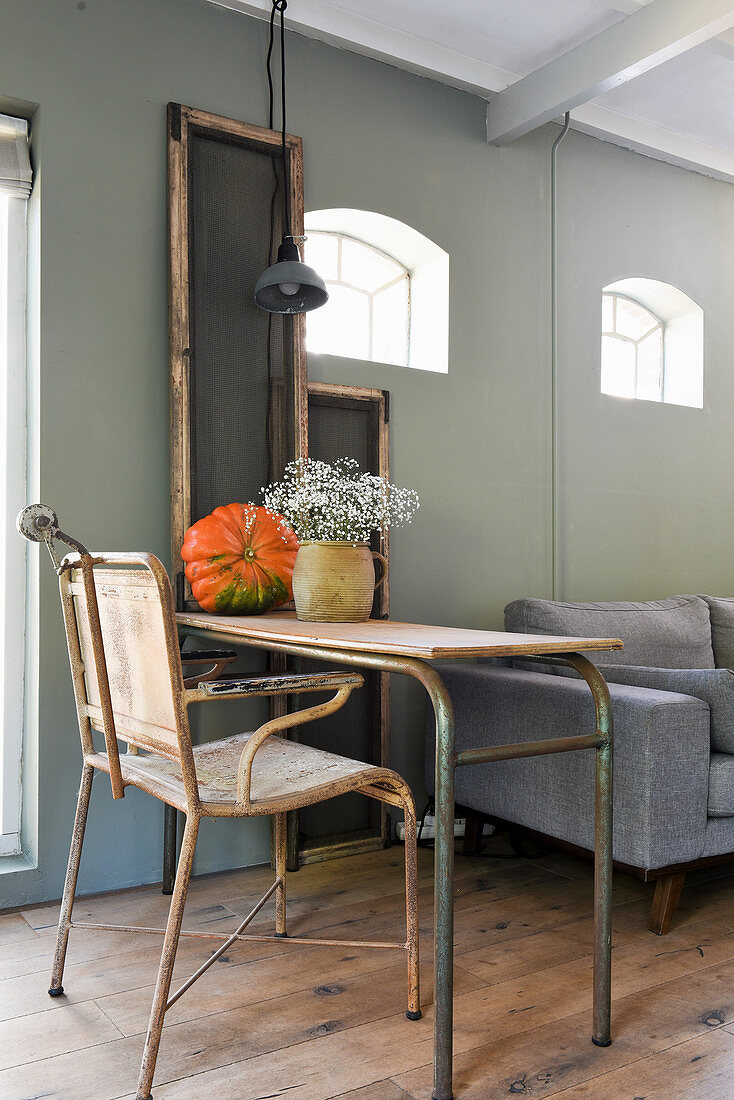 Old chair at metal desk in vintage-style living room