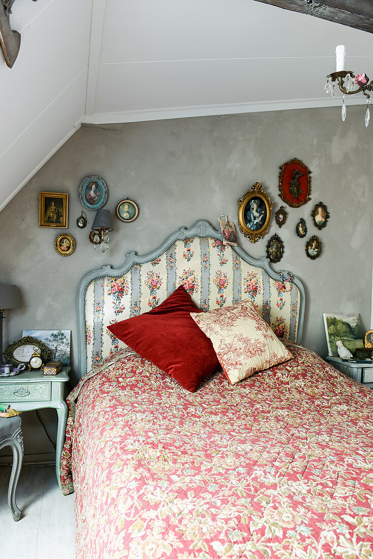 Bed with pretty headboard in vintage-style bedroom
