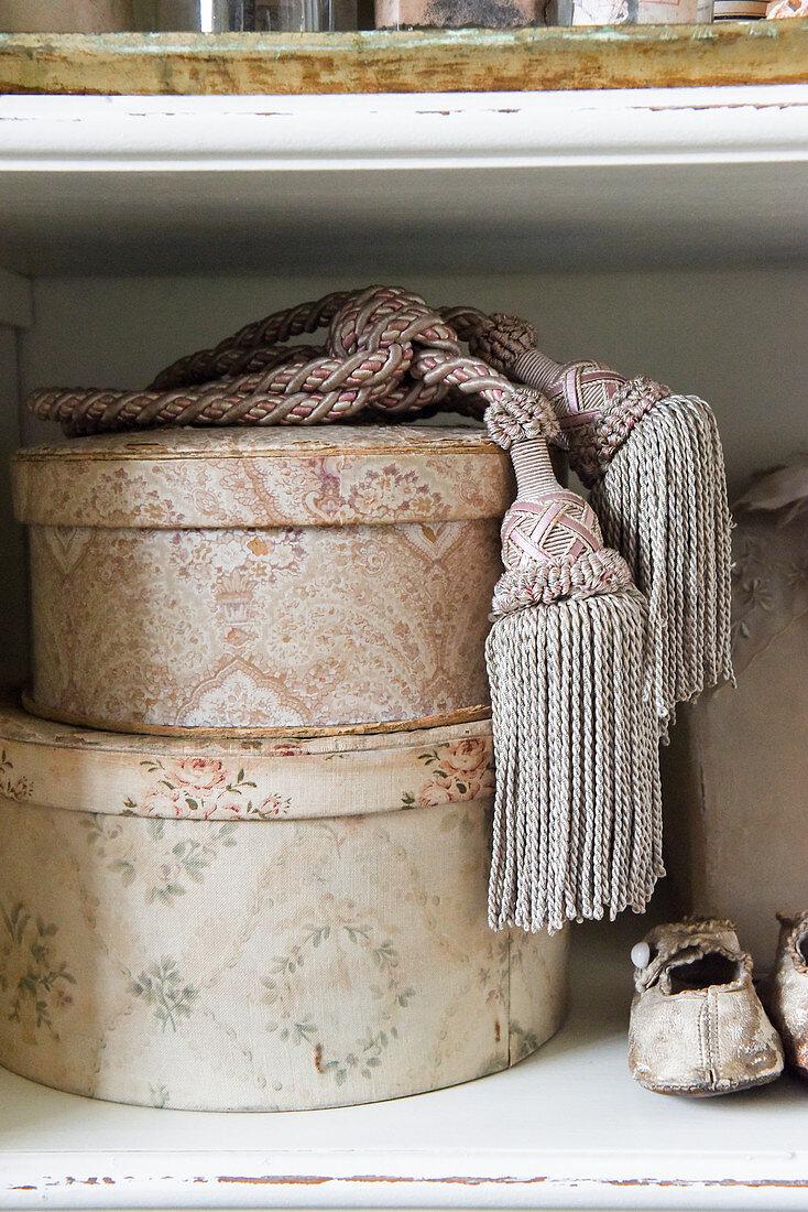 Vintage-style arrangement of tassels on old hat boxes
