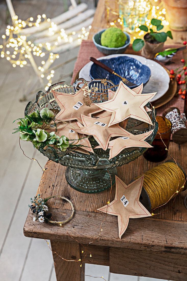 Handmade Advent calendar of star-shaped brown-paper packages