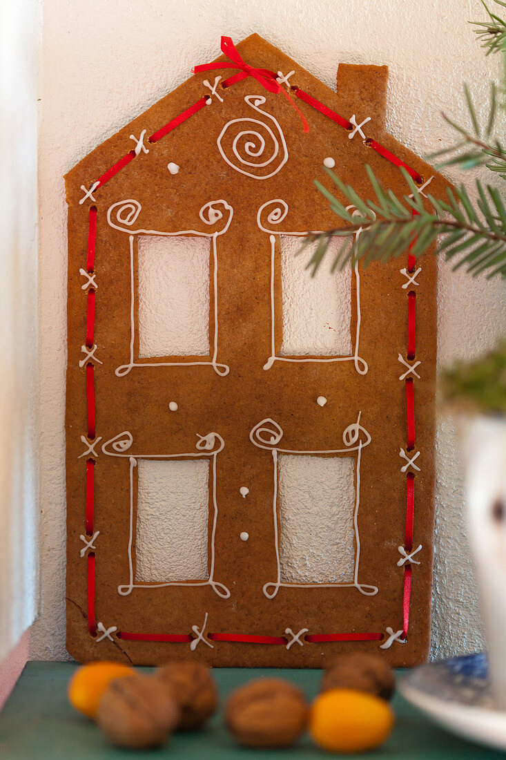 Gingerbread house (facade) decorated with a red ribbon