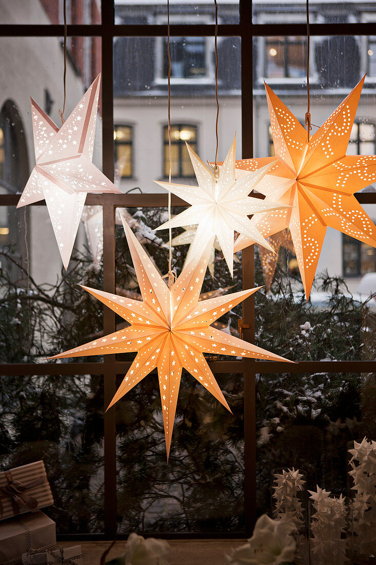 Christmas stars arranged in window
