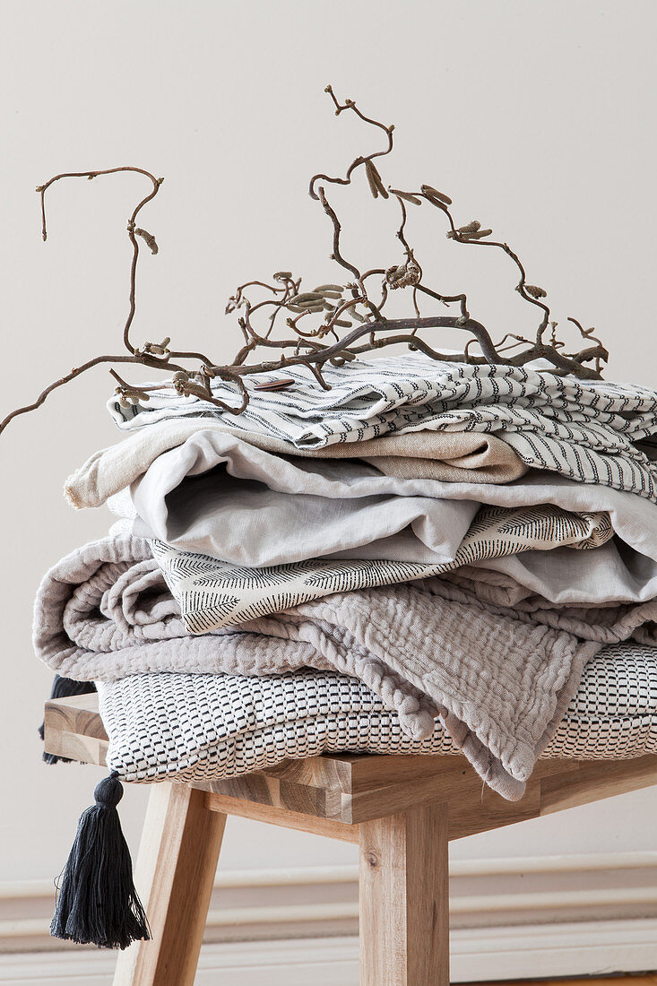 Natural fabrics on wooden bench