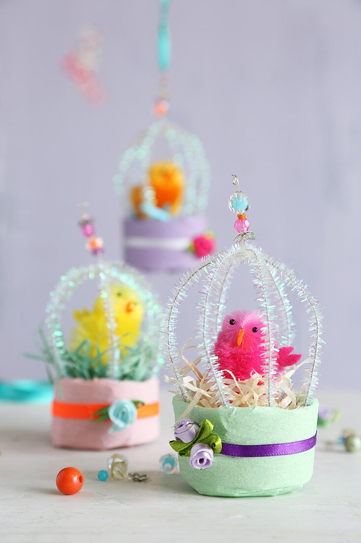 Plush chicks in handmade miniature cages