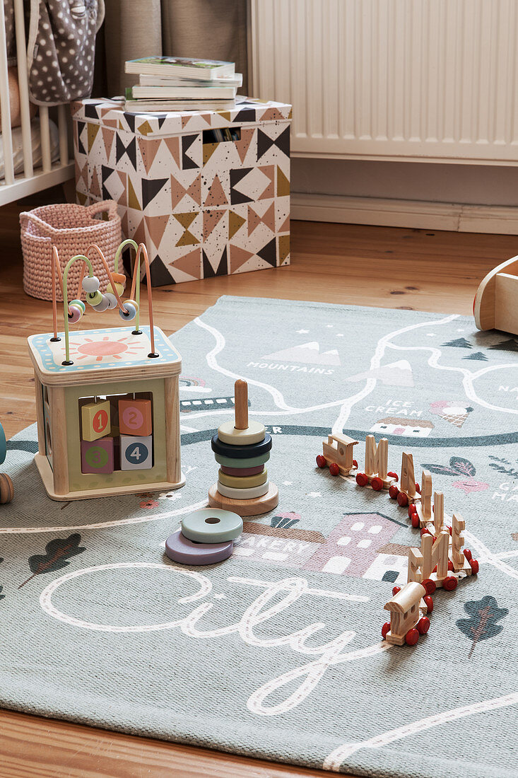 Wooden toys on play mat in child's bedroom