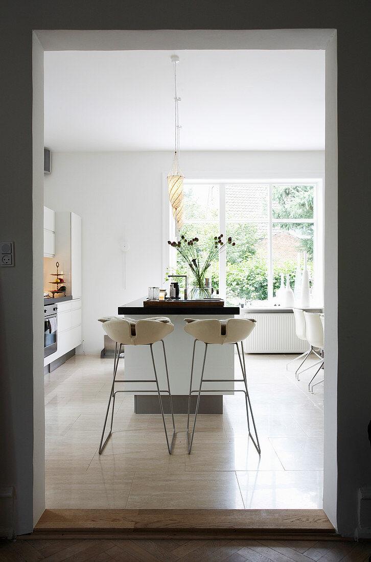 Designer barstools at kitchen island