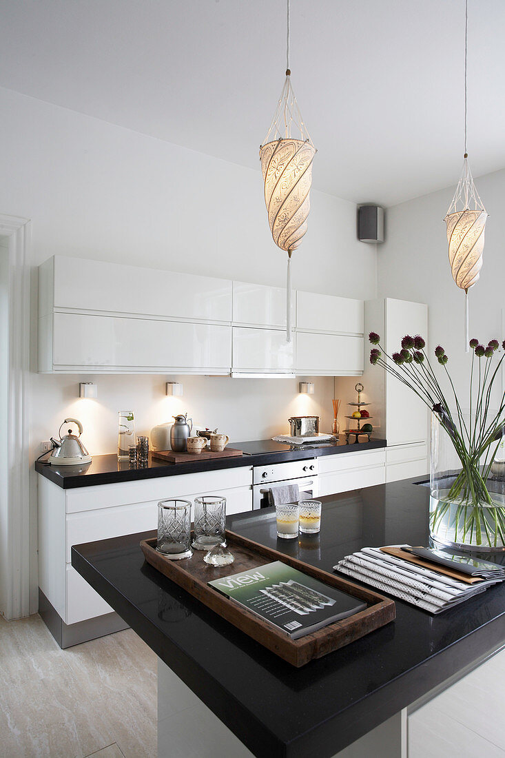 White kitchen counter and island counter with black stone top