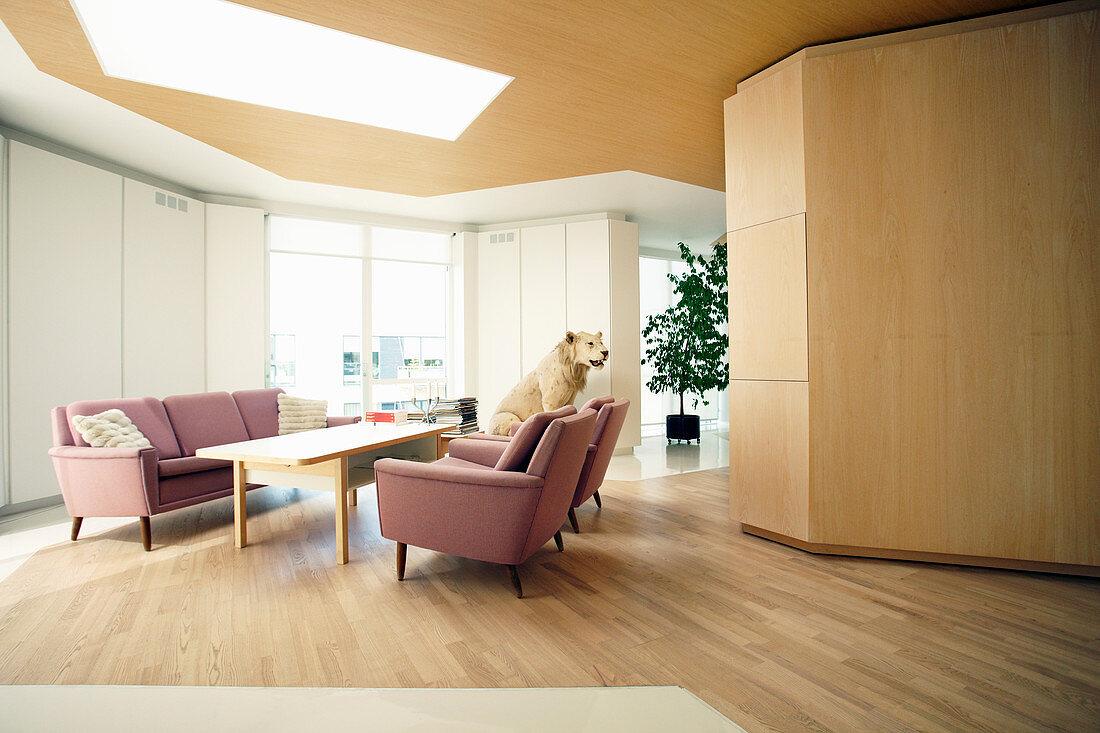 Pink sofa set in open-plan interior