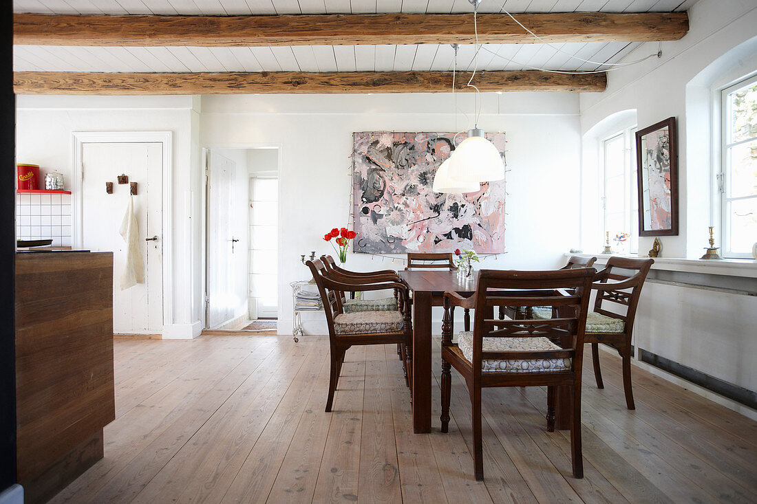 Dining table and armchairs in open-plan kitchen
