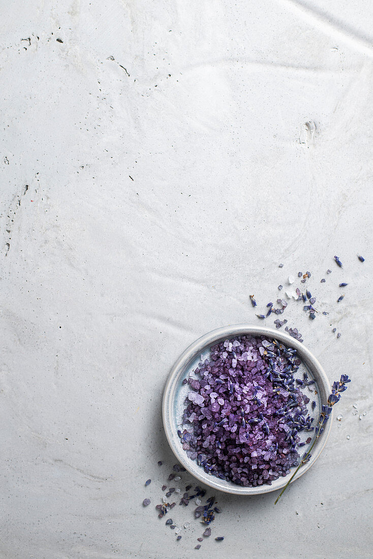 Colourful bath salts with lavender flowers