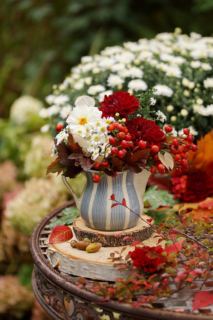 Autumn bouquet of dahlias and red berries