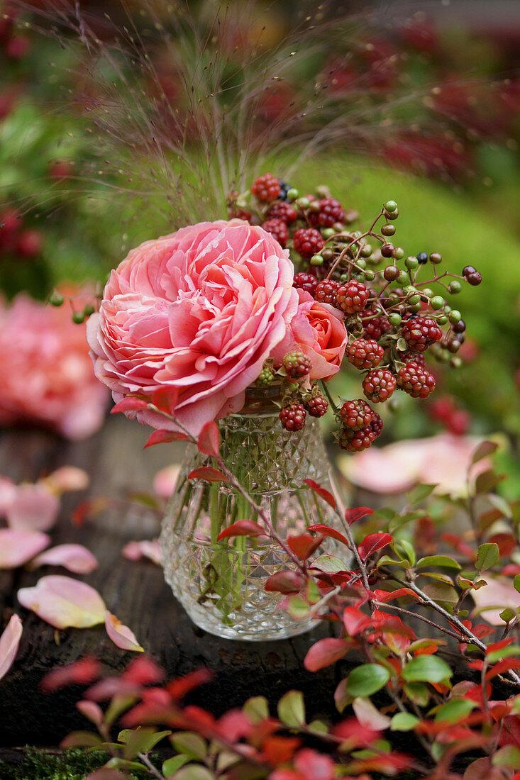 Bouquet of roses, everlasting flowers, blackberries and elderberries