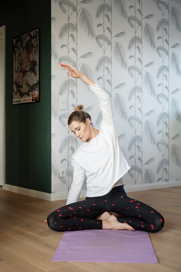 Blonde woman doing yoga exercise