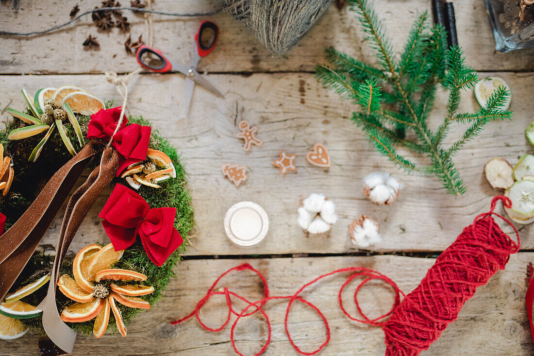 DIY Christmas wreath on wooden table