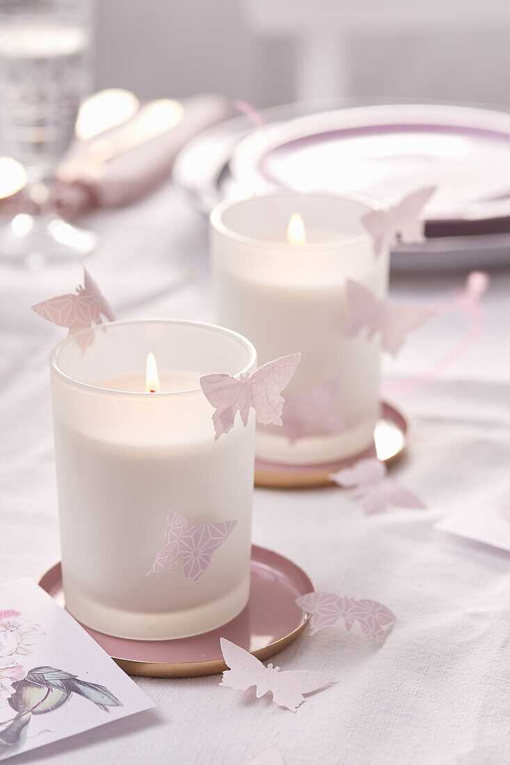 Paper butterflies decorating candels