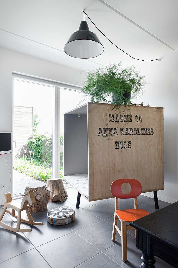 Wooden crate used to make a room within a room for children