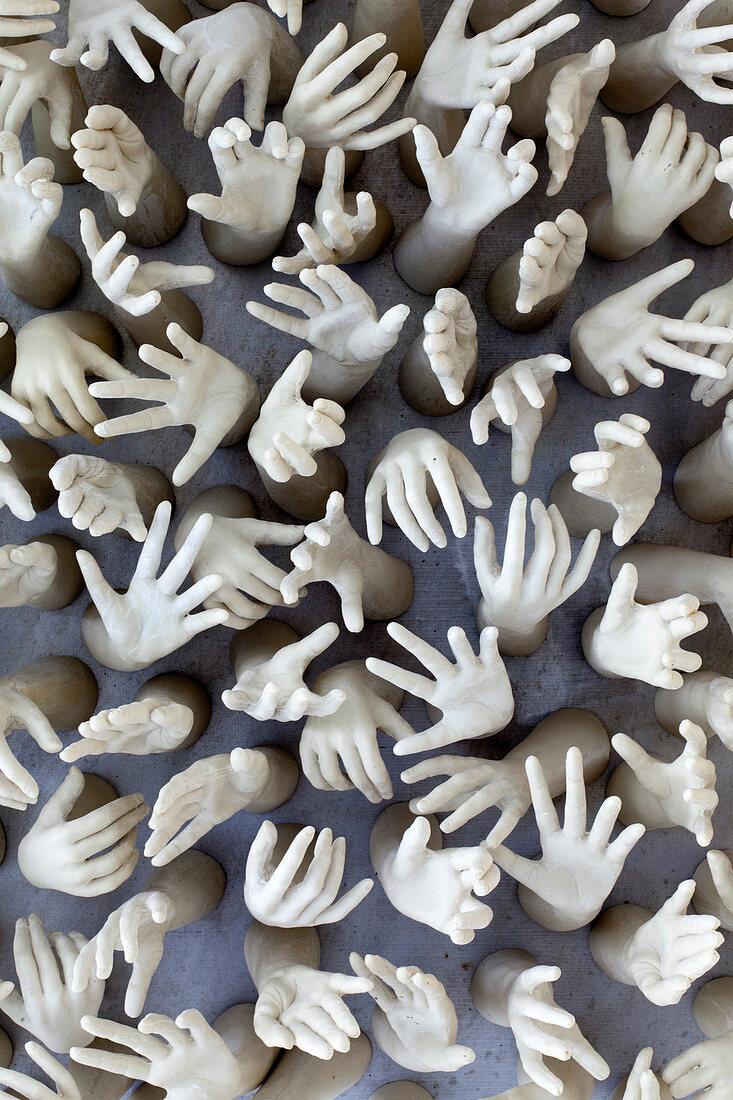 Artwork featuring multiple hands