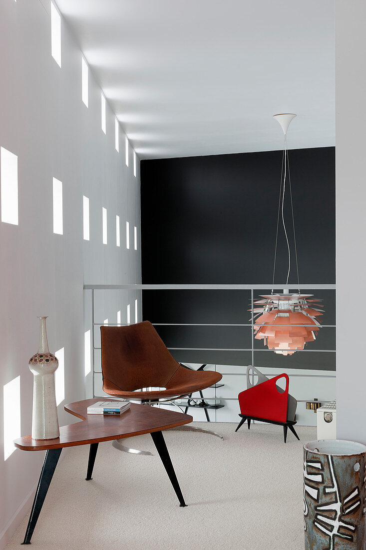 Retro furniture on gallery in modern, architect-designed house