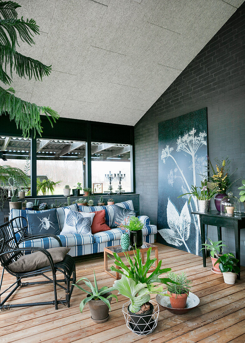 Houseplants in living room with botanical motifs