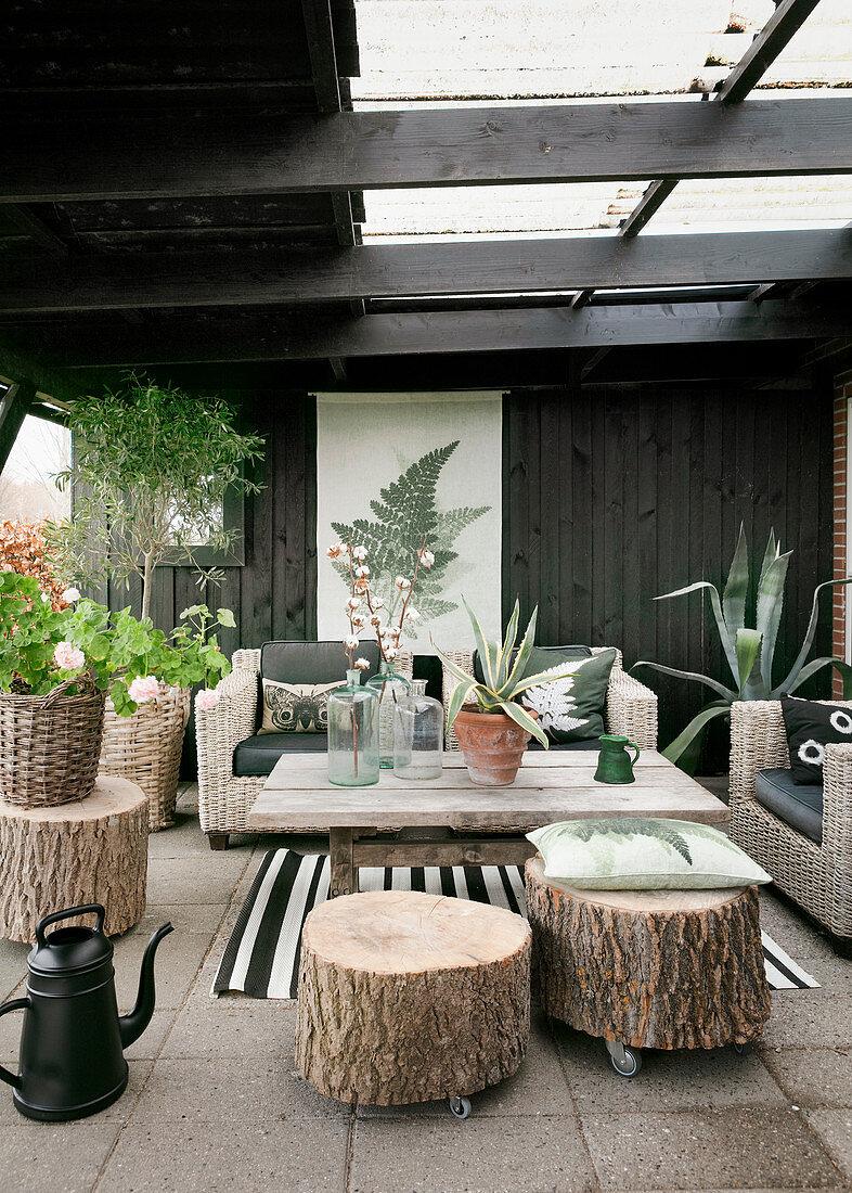 Tree stump stools on castors on roofed terrace
