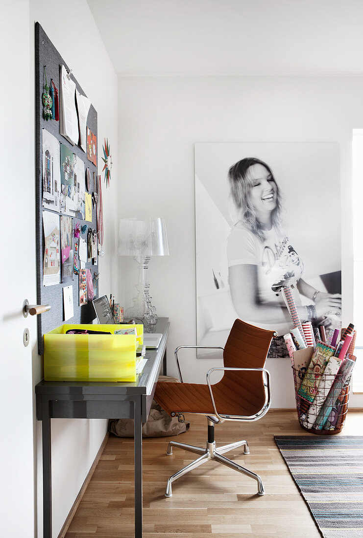 Desk, pinboard and photo portrait of young woman in study