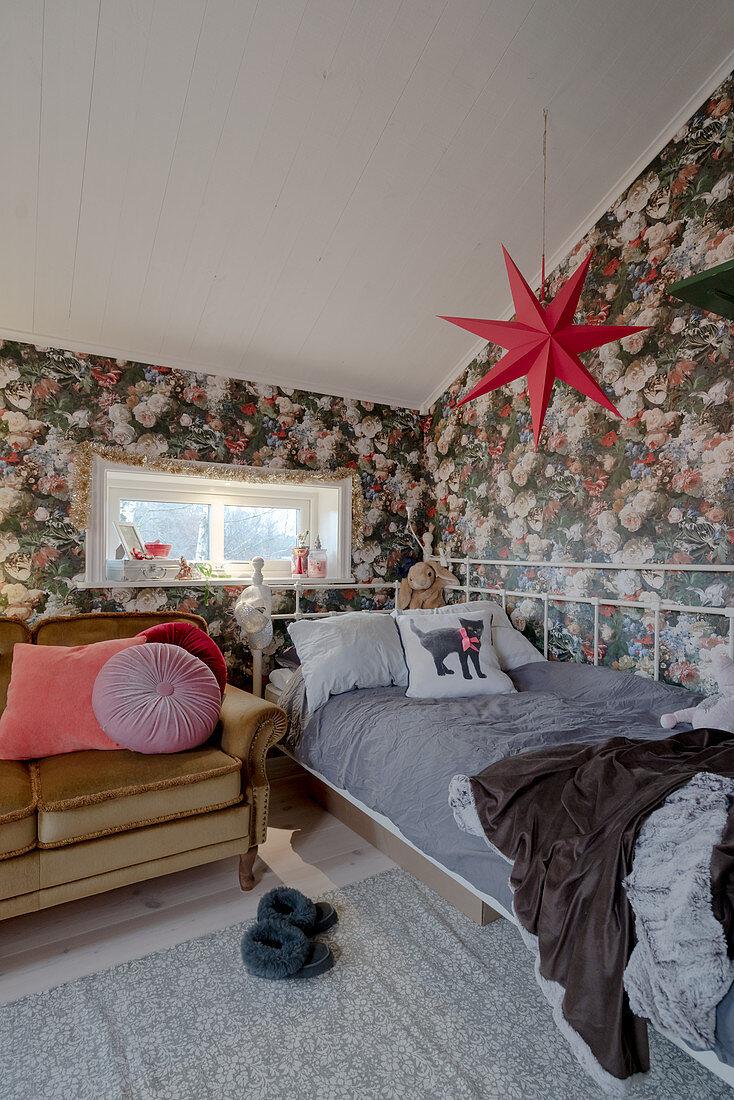 Metal bed and opulent floral wallpaper in vintage-style teenager's bedroom