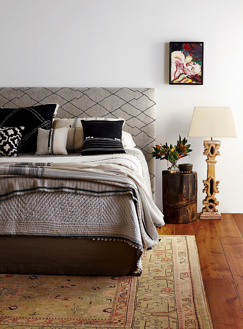 Double bed with headboard upholstered in diamond-patterned fabric