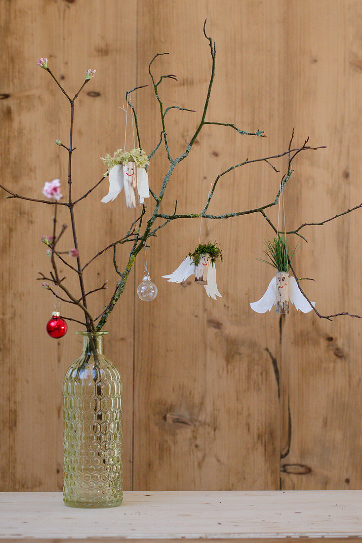 Angels made from wood, paper wings and pine-needle and moss hair